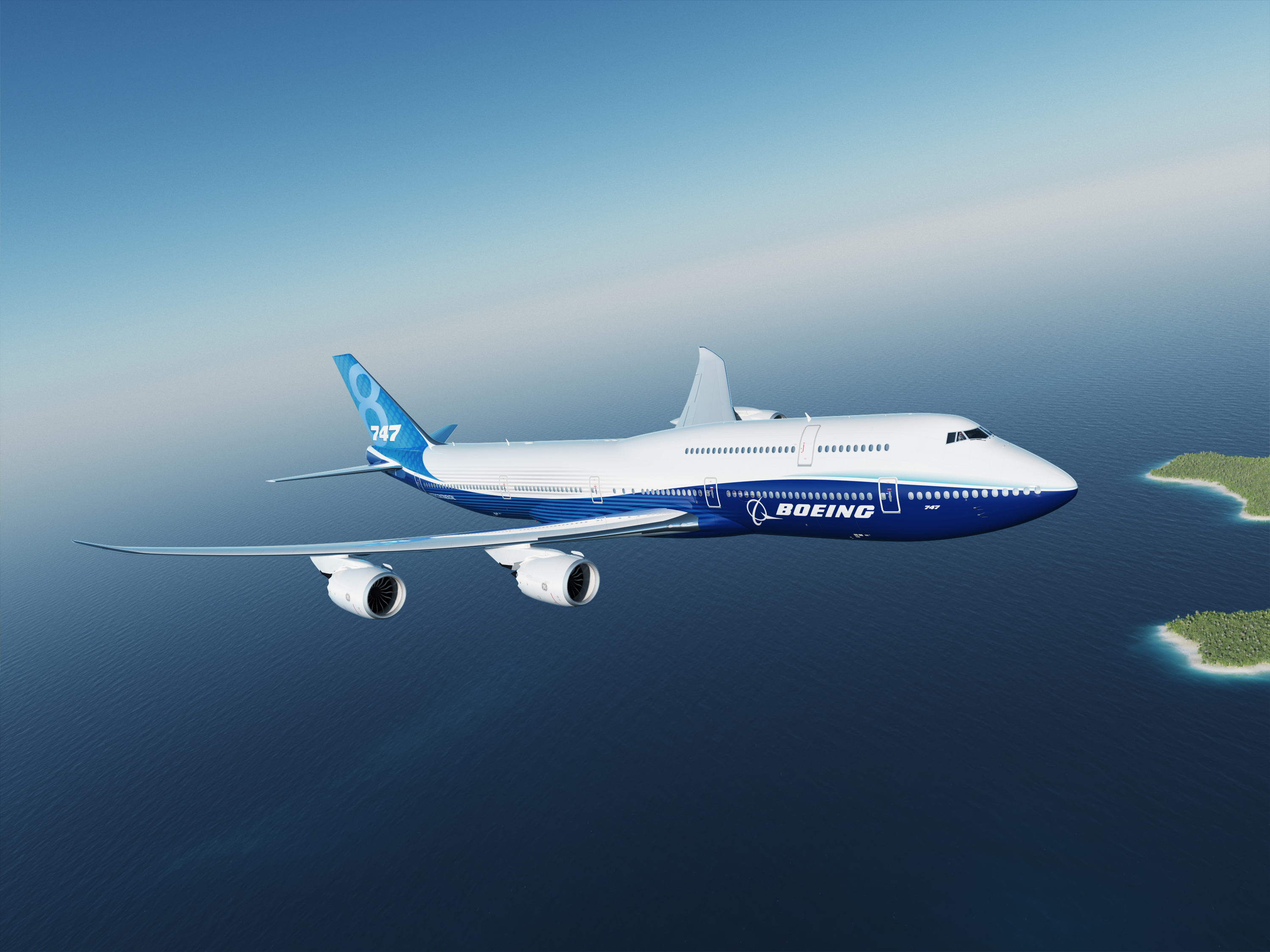 K66740; 747-8I; Boeing Blue Livery; Air to Air; Over Tropical Water; Island below